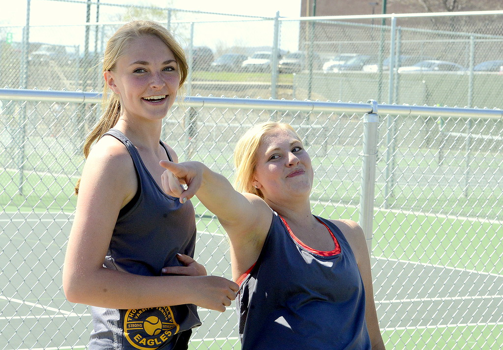. Thompson Valley\'s Danielle Sobraske points to Mike Jamieson as partner Jorden Mertens laughs after the tandem won the No. 1 doubles title with a 2-6, 6-2, 6- victory over Greeley West on Friday at the 4A Region 4 tournament at North Lake Park. (Mike Brohard/Loveland Reporter-Herald)