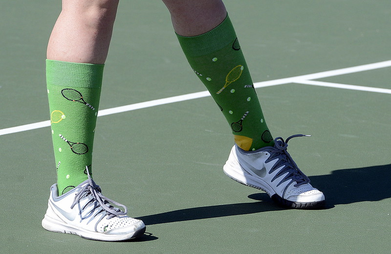 The best socks in the draw at the 4A Region 4 tournament at North Lake Park belonged to Mountain View No. 1 doubles player Dusty Berglund. (Mike Brohard/Loveland Reporter-Herald)