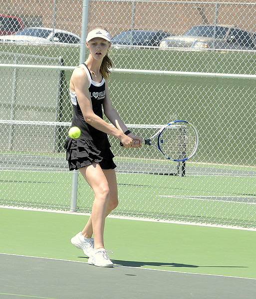 Loveland No. 3 singles player Ava McQuade eyes a backhand during the championship match of the 4A Region 4 tournament Friday at North Lake Park. (Mike Brohard/Loveland Reporter-Herald)