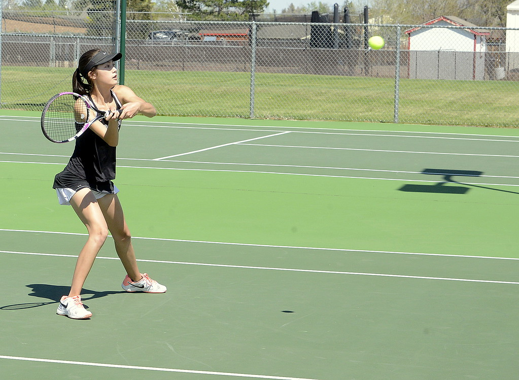 . Loveland No. 4 doubles player Tara Jeffries eyes a return during Friday\'s championship match at the 4A Region 4 tournament at North Lake Park. (Mike Brohard/Loveland Reporter-Herald)