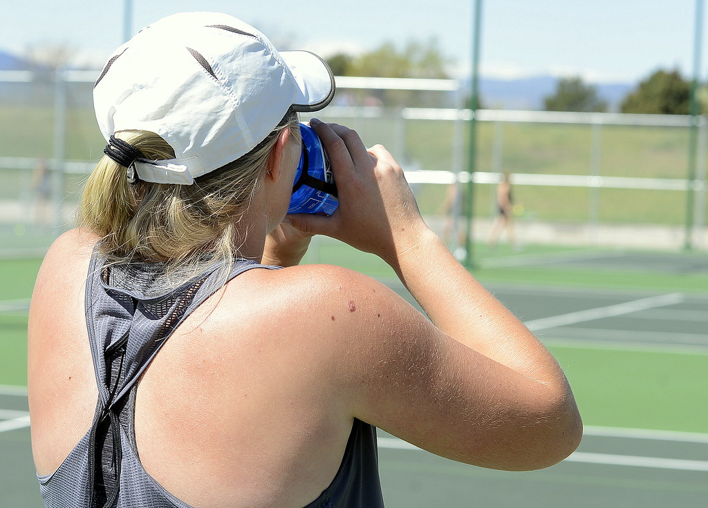 . Hydration was key as the teams plowed through the 4A Region 4 tournament on Friday at North Lake Park after two days of rain led to delays. (Mike Brohard/Loveland Reporter-Herald)