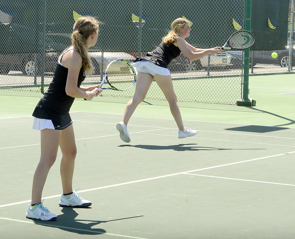 . Loveland\'s Allison Westbrook stretches out for a backhand return as No. 3 doubles partner Rebecca Emme looks on during their championship match  Friday at the 4A Region 4 tournament at North Lake Park. (Mike Brohard/Loveland Reporter-Herald)