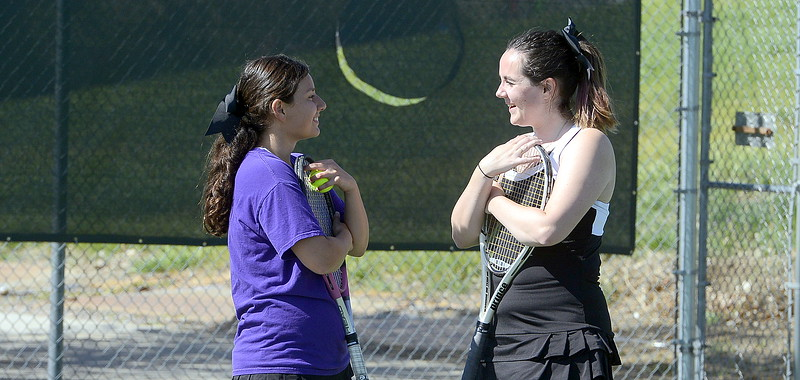 Mountain View's No. 1 doubles team of Kali Kelley (left) and Dusty Berglund chat during a break in the action Friday at the 4A Region 4 tournament at North Lake Park. (Mike Brohard/Loveland Reporter-Herald)