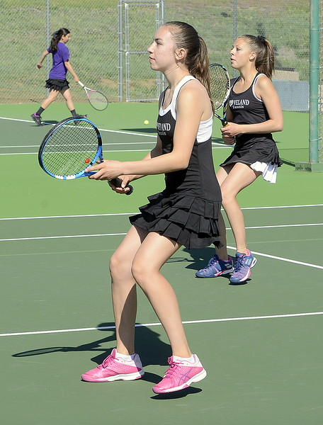 Loveland's No. 2 doubles team of Megan Lindsey (front) and Aubrey Woodard stay alert Friday at the 4A Region 4 tournament at North Lake Park. (Mike Brohard/Loveland Reporter-Herald)