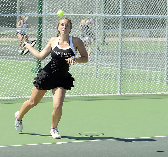 Loveland No. 1 singles player Kira Badberg as her attention fixed as she hits a return Friday at the 4A Region 4 tournament at North Lake Park. (Mike Brohard/Loveland Reporter-Herald)