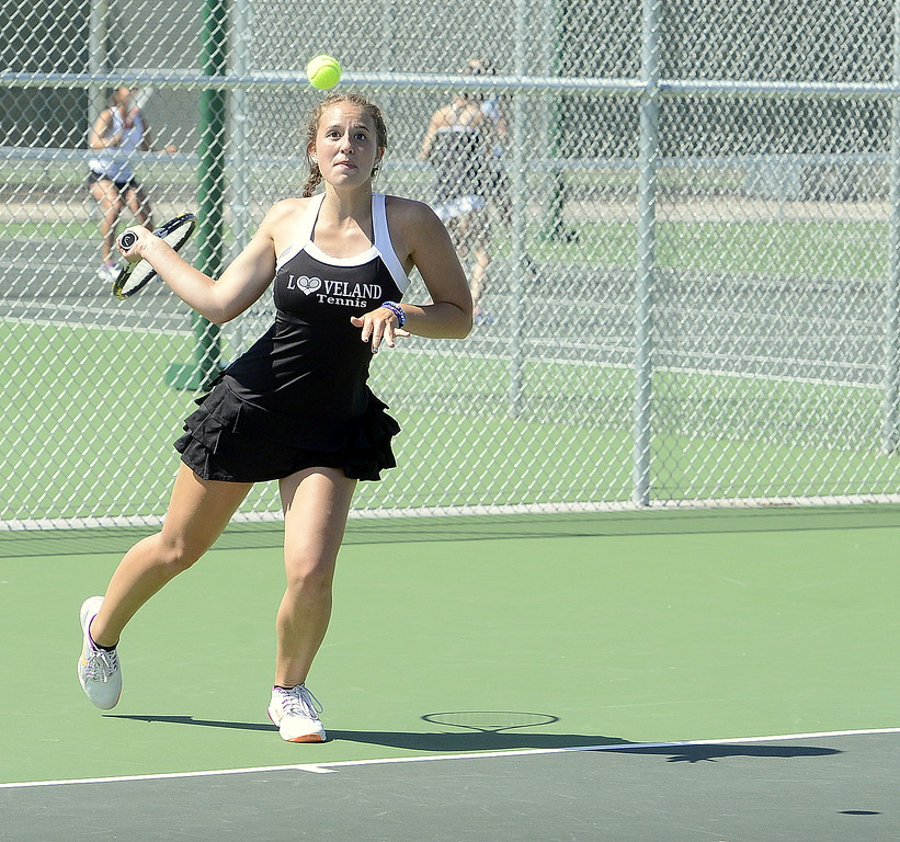 . Loveland No. 1 singles player Kira Badberg as her attention fixed as she hits a return Friday at the 4A Region 4 tournament at North Lake Park. (Mike Brohard/Loveland Reporter-Herald)