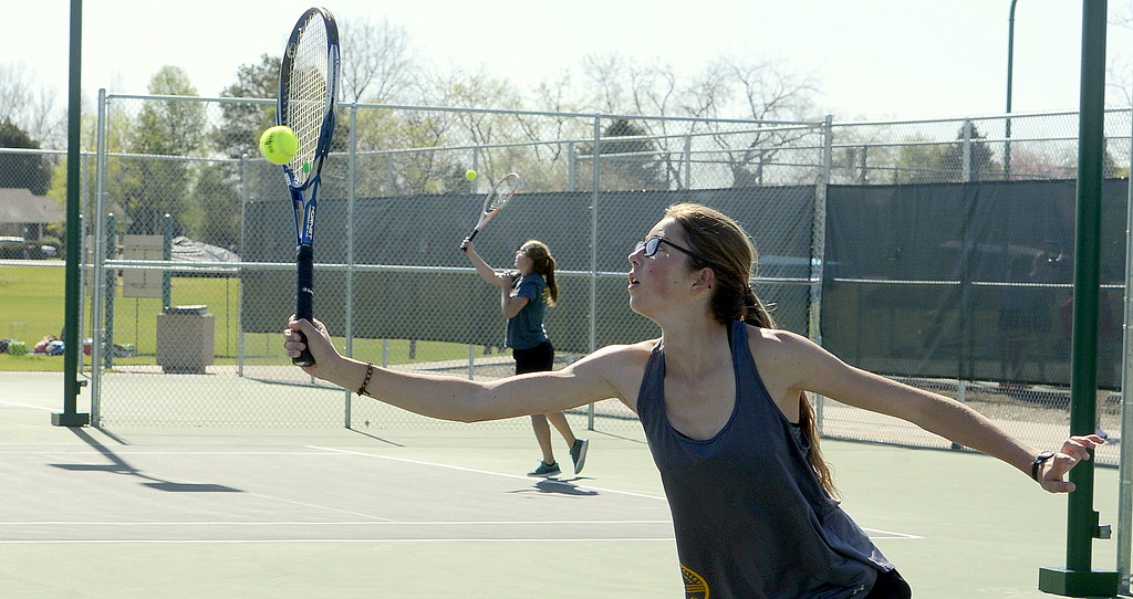 . Thompson Valley No. 2 singles player Kylie Jacobson returns a shot in the first round Friday at the 4A Region 4 tournament at North Lake Park. (Mike Brohard/Loveland Reporter-Herald)