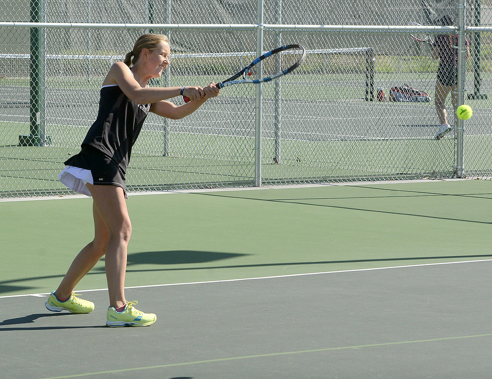. Loveland No. 2 singles player Alix Huhta hits a backhand during Friday\'s 4A Region 4 tournament at North Lake Park. (Mike Brohard/Loveland Reporter-Herald)