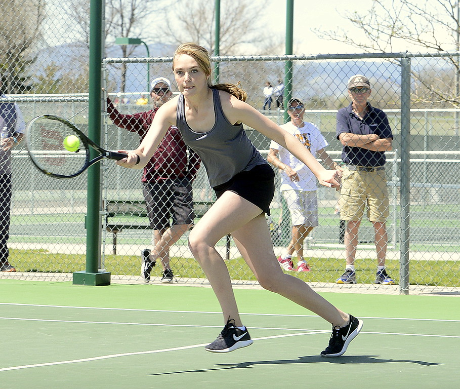 . Thompson Valley No. 1 doubles player Jorden Mertens gets to a return in the semifinals Friday at the 4A Region 4 tournament at North Lake Park. (Mike Brohard/Loveland Reporter-Herald)