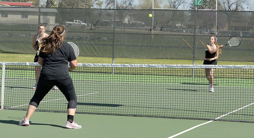 . Thompson Valley No. 2 doubles player Kaitlin Morris is ready at the net at Mountain View\'s Karmin Whipple returns a shot during their opening-round match Friday at the 4A Region 4 tournament at North Lake Park. (Mike Brohard/Loveland Reporter-Herald)