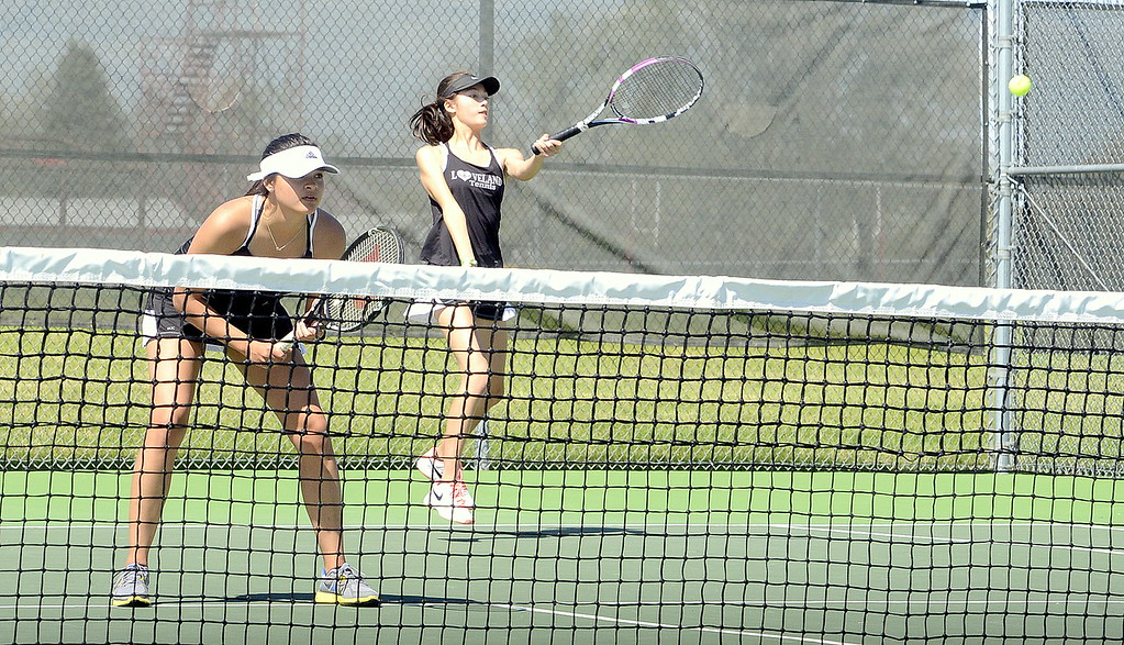 . Loveland\'s Alisa Sautter is ready at the net as No. 3 doubles partner Tara Jeffries returns a serve in the championship match Friday at the 4A Region 4 tournament at North Lake Park. (Mike Brohard/Loveland Reporter-Herald)