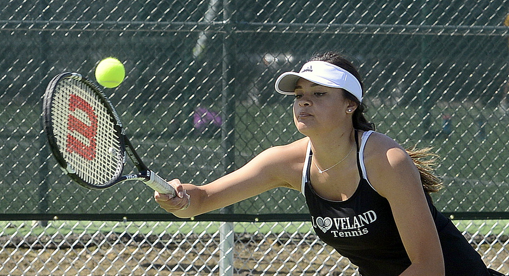 . Loveland No. 4 doubles player Alisa Sautter reaches out for a forehand return Friday at the 4A Region 4 tournament at North Lake Park. (Mike Brohard/Loveland Reporter-Herald)