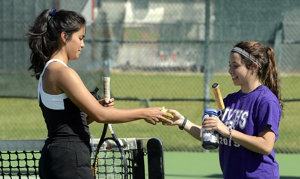 . Mountain View\'s No. 4 doubles team of Janette Perez (left) and Taylor Mills take a break during Friday\'s 4A Region 4 tournament at North Lake Park. (Mike Brohard/Loveland Reporter-Herald)