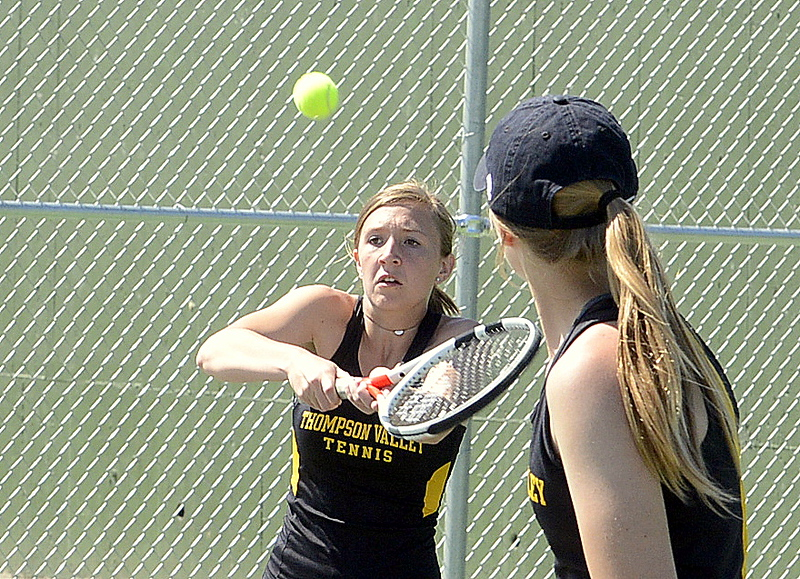 . Thompson Valley\'s Autumn Porter returns a shot as No. 4 doubles parner Sydney Laws looks on during their match Friday at the 4A Region 4 tournament at North Lake Park. (Mike Brohard/Loveland Reporter-Herald)
