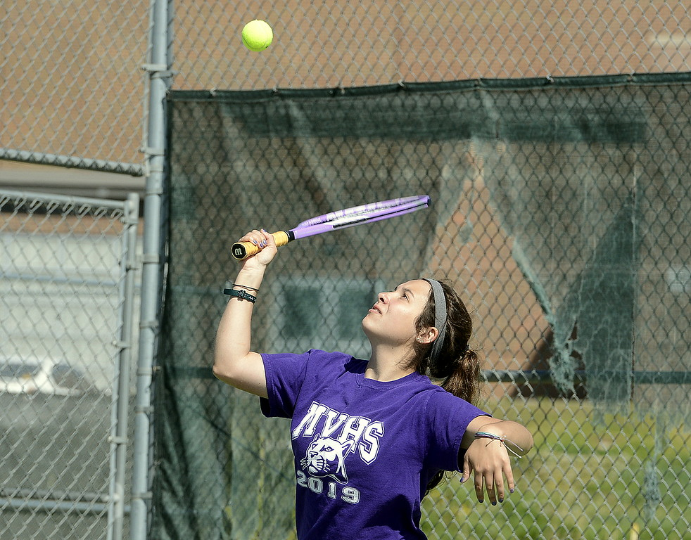 . Taylor Mills of Mountain View watches the ball as she serves during her No. 4 doubles match Friday at the 4A Region 4 tournament at North Lake Park. (Mike Brohard/Loveland Reporter-Herald)