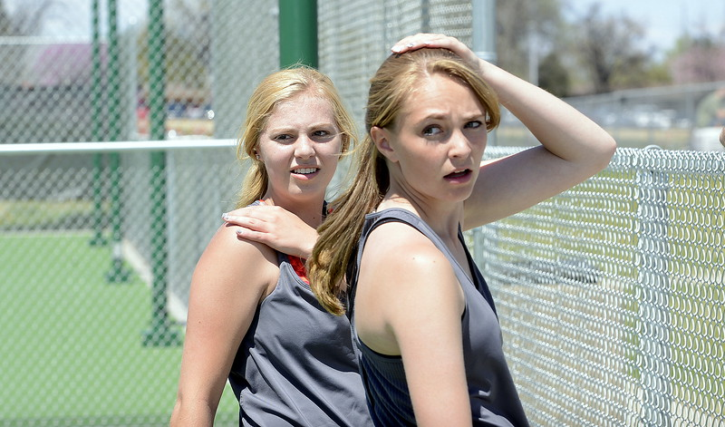 Thompson Valley's No. 1 doubles players Danielle Sobraske (back) and Jorden Mertens look back over their shoulders at their opponents from Greeley West as they listen to coach Jay Klagge at Friday's 4A Region 4 tennis tournament at North Lake Park. The Eagles duo won the title with a 2-6, 6-2, 6-1 victory. (Mike Brohard/Loveland Reporter-Herald).