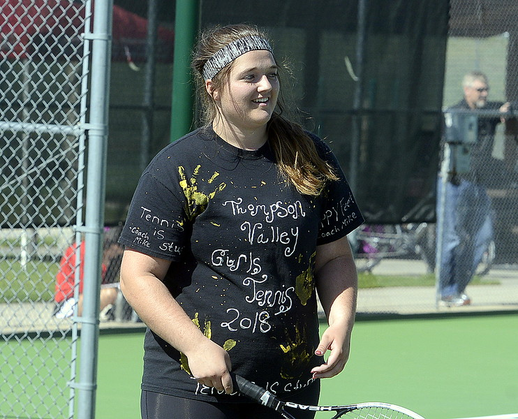 Thompson Valley No. 2 doubles player Kaitlin Morris was all about team spirit with her personally designed T-shirt in the first round Friday at the 4A Region 4 tournament at North Lake Park. (Mike Brohard/Loveland Reporter-Herald)