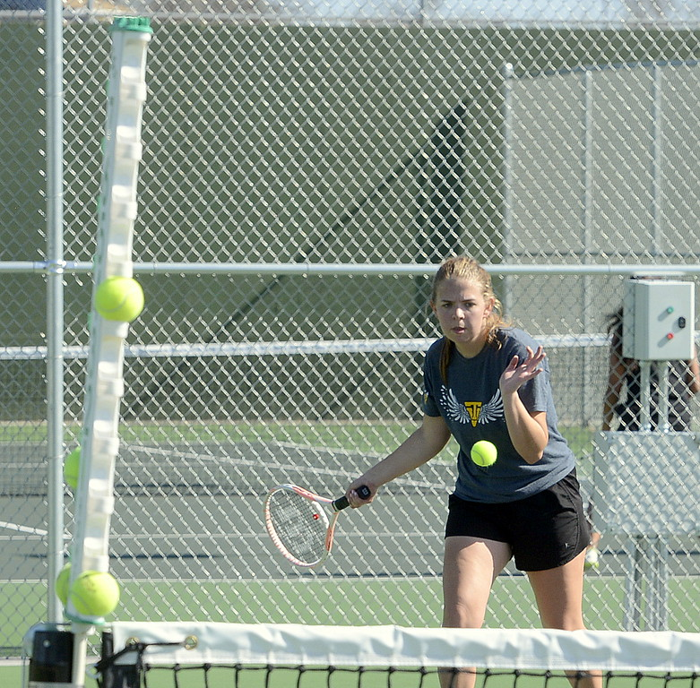 . Anna Cormos of Thompson Valley moves in to hit a forehand Friday at the 4A Region 4 tournament at North Lake Park. (Mike Brohard/Loveland Reporter-Herald)
