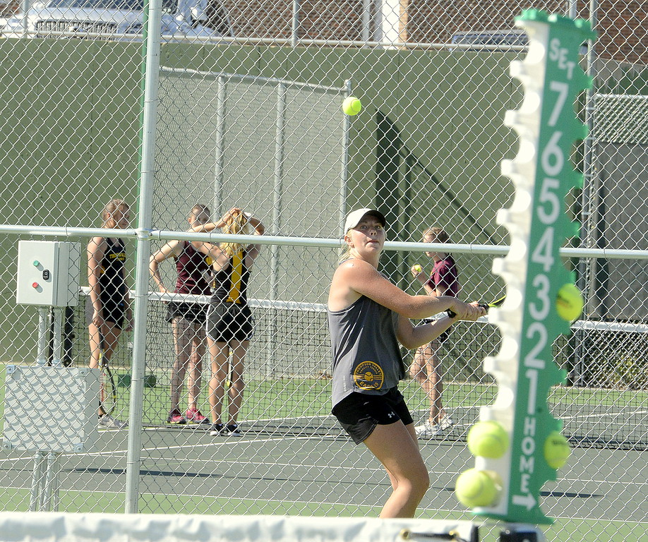 . The scoreboard tells the tale as Thompson Valley No. 1 singles player Maddie Sheets returns a shot during Friday\'s championship match at the 4A Region 4 tournament at North Lake Park. Sheets won her first 17 games before droppiing one on her way to the title, capped with a 6-1, 6-1 win over Windsor\'s Taylor Pankewicz. (Mike Brohard/Loveland Reporter-Herald)
