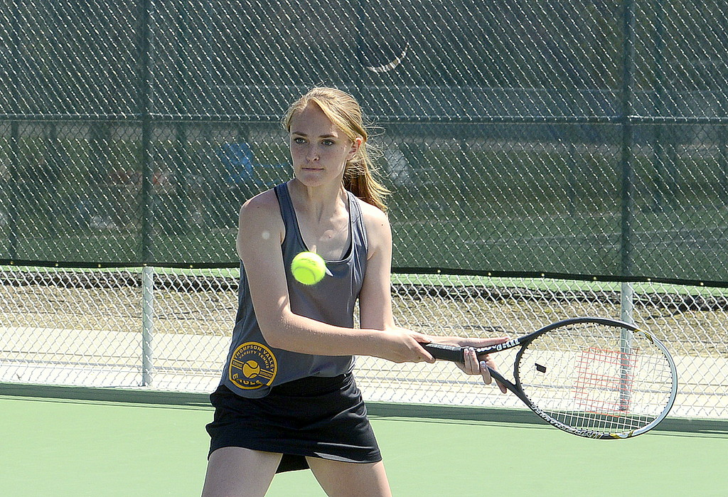 . Jorden Mertens of Thompson Valley focuses on the ball during Friday\'s championship match at No. 1 doubles at the 4A Region 4 tournament at North Lake Park. (Mike Brohard/Loveland Reporter-Herald)