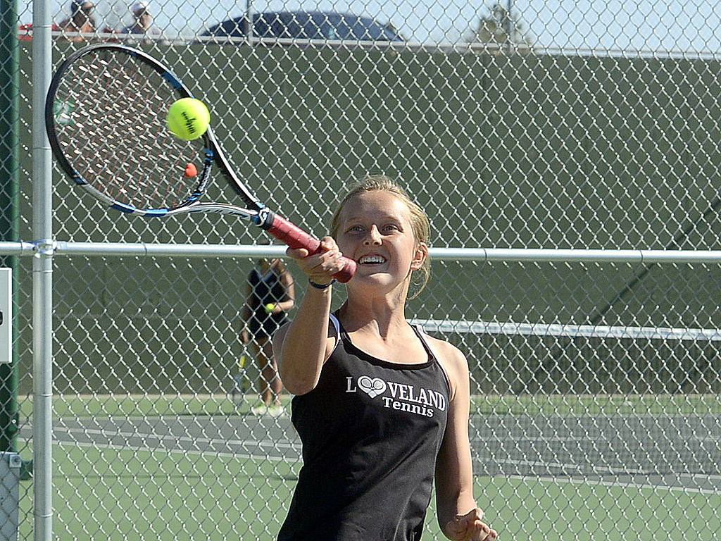. Loveland No. 2 singles player Alix Huhta returns a shot in her opening match Friday at the 4A Region 4 tournament at North Lake Park. (Mike Brohard/Loveland Reporter-Herald)
