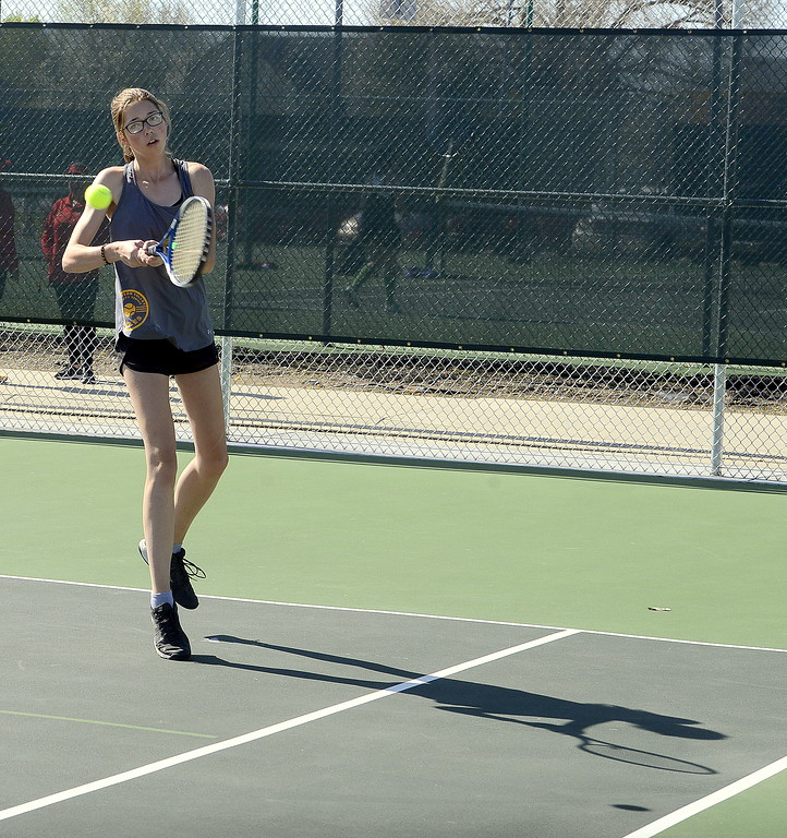 . Thompson Valley No. 2 singles player Kylie Jacobson hits a backhand during Friday\'s 4A Region 4 tournament at North Lake Park. (Mike Brohard/Loveland Reporter-Herald)