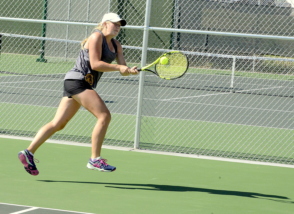 . Thompson Valley\'s Maddie Sheets hustles back for a backhand return during  Friday\'s No. 1 singles championship match at the 4A Region 4 tournament at North Lake Park. (Mike Brohard/Loveland Reporter-Herald)