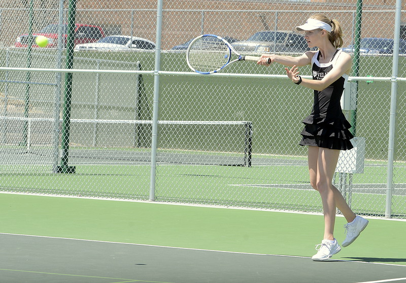 Loveland's Ava McQuade hits a forehand return during  Friday's championship match at the 4A Region 4 tournament at North Lake Park. (Mike Brohard/Loveland Reporter-Herald)