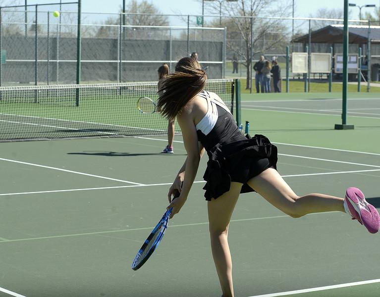 Loveland's Megan Lindsey serves Friday during the 4A Region 4 tournament at North Lake Park. (Mike Brohard/Loveland Reporter-Herald)