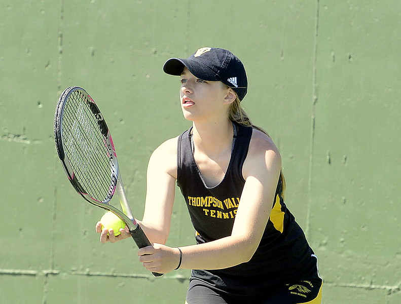 Sydney Laws of Thompson Valley stares across the net as she prepares to serve during the No. 4 doubles third-place match Friday at the 4A Region 4 tournament at North Lake Park. (Mike Brohard/Loveland Reporter-Herald)