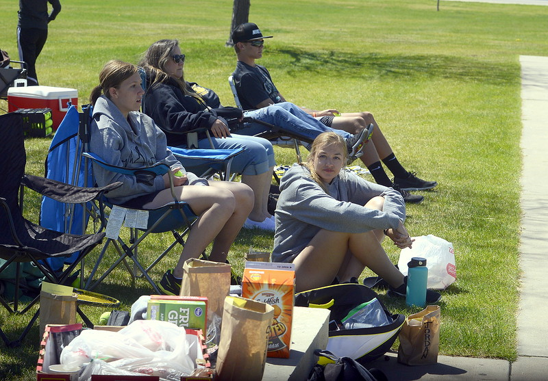 Thompson Valley fans line up along court nine to watch the No. 3 doubles team of Lacy Sauer and Kaeylin Geifer play back-to-back matchs there Friday during the 4A Region 4 tournament at North Lake Park. (Mike Brohard/Loveland Reporter-Herald)
