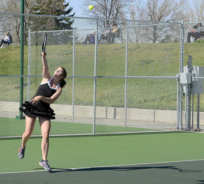 Mountain View No. 1 singles player Megan Heesemann unleashes a serve Friday during the 4A Region 4 tournament at North Lake Park. (Mike Brohard/Loveland Reporter-Herald)