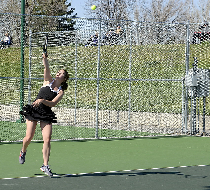. Mountain View No. 1 singles player Megan Heesemann unleashes a serve Friday during the 4A Region 4 tournament at North Lake Park. (Mike Brohard/Loveland Reporter-Herald)