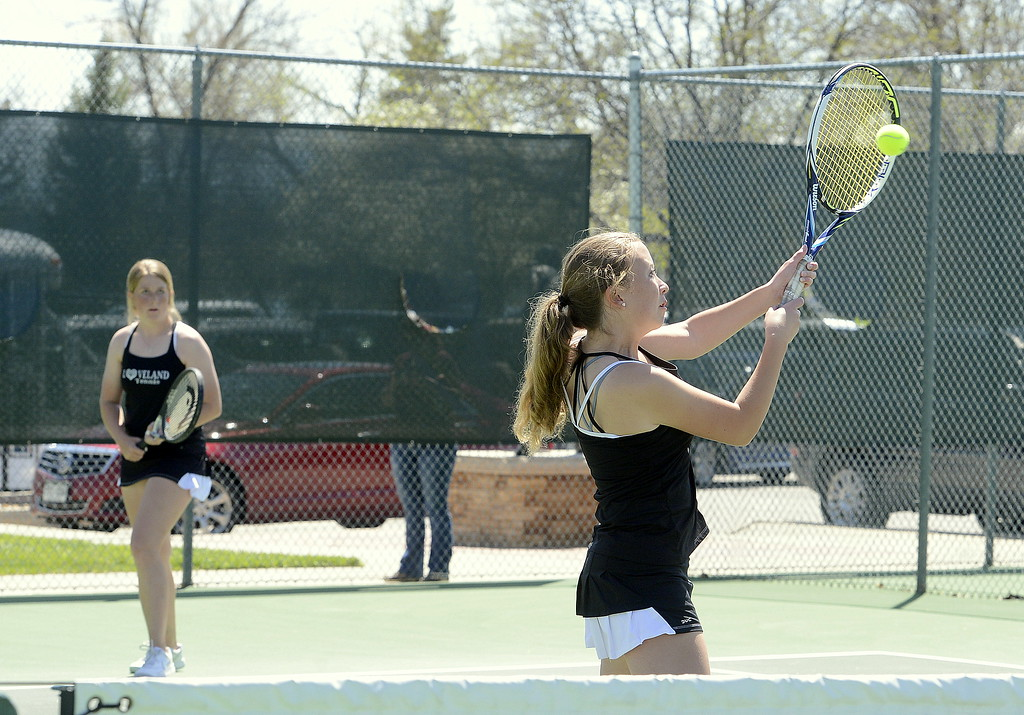 . Loveland\'s Rebecca Emme hits a return as No. 3 doubles partner Allison Westbrook looks on during the championship match Friday at the 4A Region 4 tournament at North Lake Park. The duo won the title with a 6-3, 6-1 victory over Windsor. (Mike Brohard/Loveland Reporter-Herald)