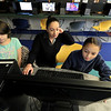 "The holidays are over and the ""Girls Who Code"" class was back in full swing at the Boys and Girls Club of Fitchburg and Leominster Saturday, January 5, 2019. Instructor Josie Rivera helps Amelia Carboni, 9, during class on Saturday. on right is Calista Hallet, 10, working on her own project. SENTINEL & ENTERPRISE/JOHN LOVE"