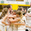 Record-Eagle/Brett A. Sommers Glen Lake celebrates its 60-56 win over St. Ignace following Tuesday's Class C quarterfinal girls basketball game at Gaylord High School.