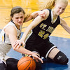 Record-Eagle/Brett A. Sommers Glen Lake's Savannah Peplinski (left) battles St. Ignace's Madison Olsen (24) for a loose ball during the second half of Tuesday's Class C quarterfinal girls basketball game at Gaylord High School. Glen Lake won 60-56.