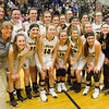 Record-Eagle/Brett A. Sommers <br /> <br /> Glen Lake poses for a team photo following Tuesday's Class C quarterfinal girls basketball game in Gaylord against St. Ignace. Glen Lake won 63-52.