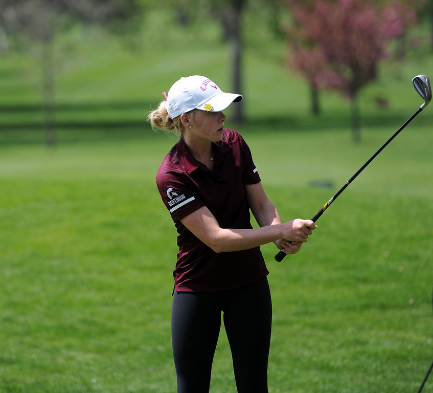 . Stephanie Haberkon chips in on the 10th hole during the 3A Region 3 tournament at Highland Hills Golf Course on Monday, April 6. (Colin Barnard/Loveland Reporter-Herald)