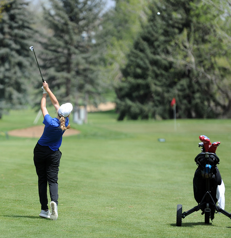 . Elisabeth Perl hits a shot into the green during the 3A Region 3 tournament at Highland Hills Golf Course on Monday, April 6. (Colin Barnard/Loveland Reporter-Herald)