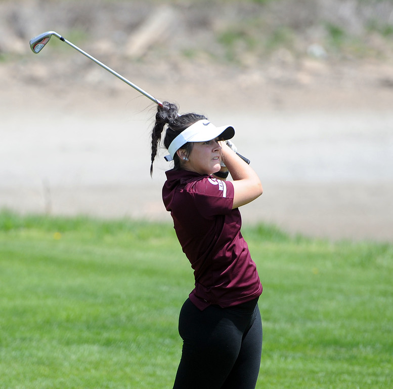 . Cora Fate watches her tee shot during the 3A Region 3 tournament at Highland Hills Golf Course on Monday, April 6. (Colin Barnard/Loveland Reporter-Herald)