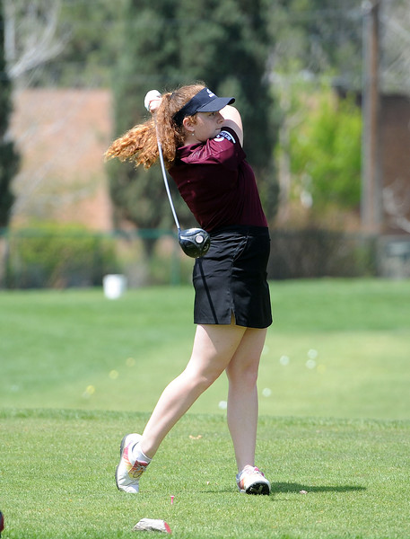 Isabel Gittings finishes a drive during the 3A Region 3 tournament at Highland Hills Golf Course on Monday, April 6. (Colin Barnard/Loveland Reporter-Herald)