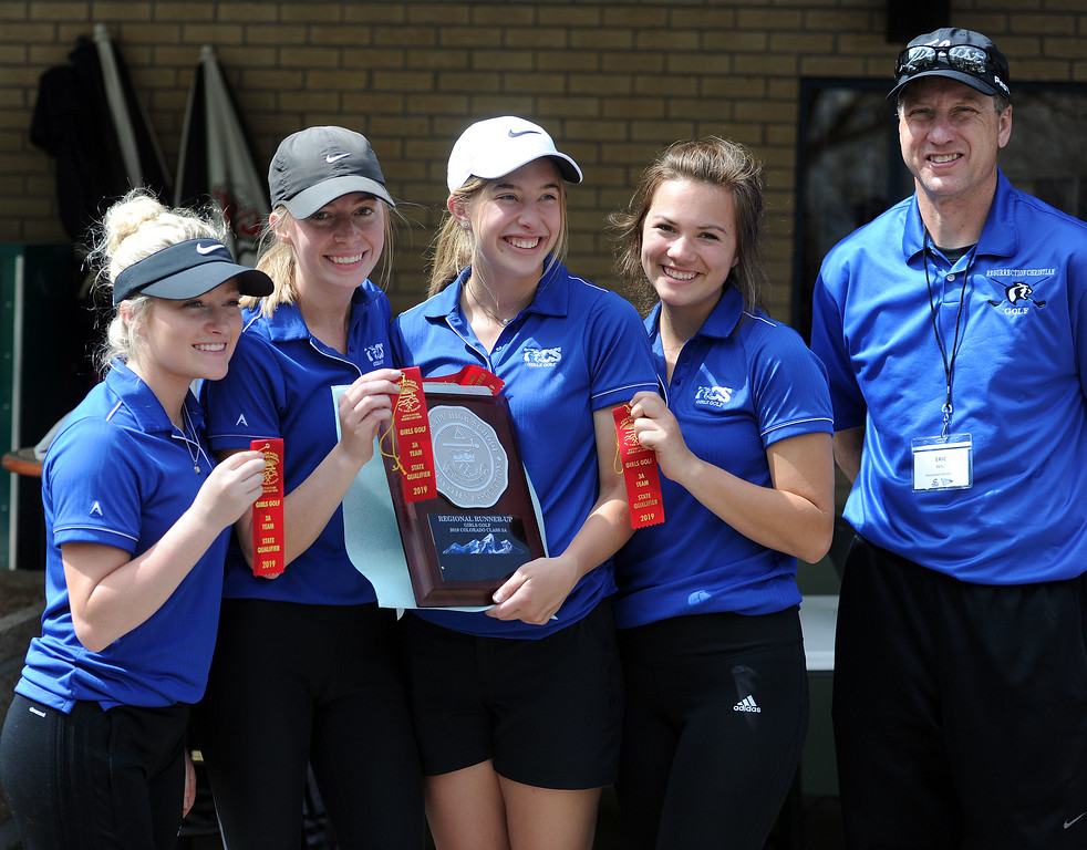 . Resurrection Christian celebrates after earning a team berth to the 3A state tournament with a second-place finish in its regional. From left to right: Colette Bangma, Sloan Dando, Elisabeth Perl, Morgan Sailor, Eric Hinz. (Colin Barnard/Loveland Reporter-Herald)