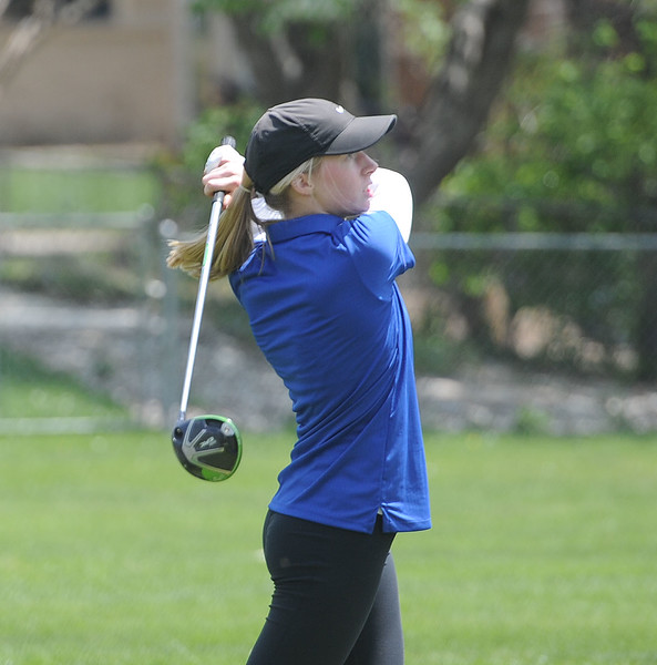 Sloan Dando eyes her tee shot during the 3A Region 3 tournament at Highland Hills Golf Course on Monday, April 6. (Colin Barnard/Loveland Reporter-Herald)