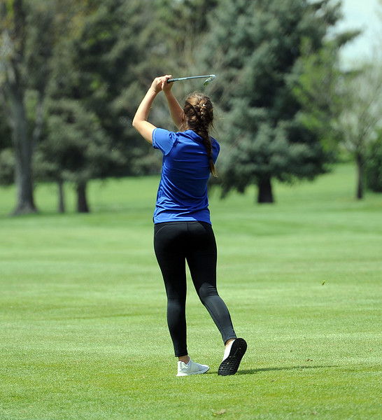 Morgan Sailor watches her second shot on the 13th hole during the 3A Region 3 tournament at Highland Hills Golf Course on Monday, April 6. (Colin Barnard/Loveland Reporter-Herald)