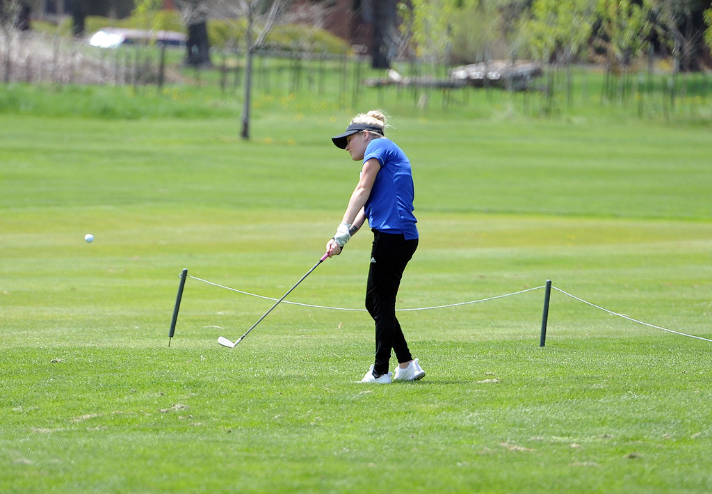 . Colette Bangma chips a ball onto the green during the 3A Region 3 tournament at Highland Hills Golf Course on Monday, April 6. (Colin Barnard/Loveland Reporter-Herald)