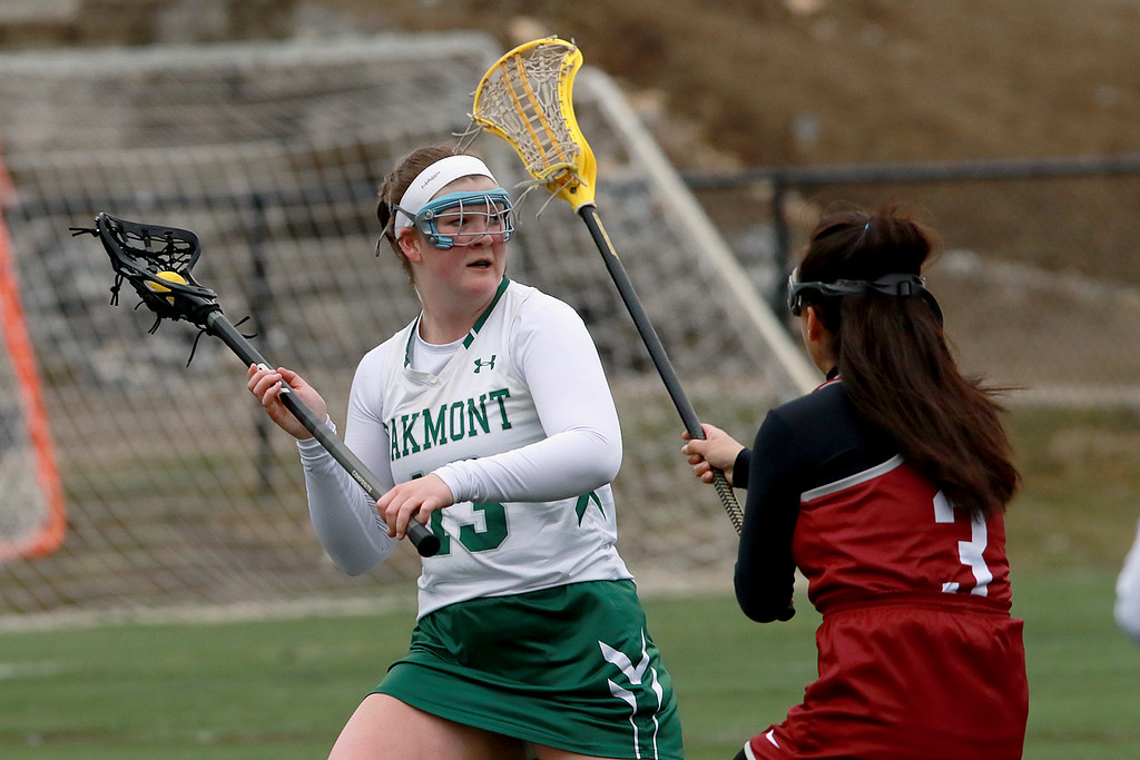. Fitchburg High School girls Lacrosse played Oakmont Regional High School on Tuesday afternoon in Ashburnham, April 9, 2019. FHS\'s Kiara Dedraza tries to stop ORHS\'s Ella LaFortune. Oakmont won, 15-1. SENTINEL & ENTERPRISE/JOHN LOVE