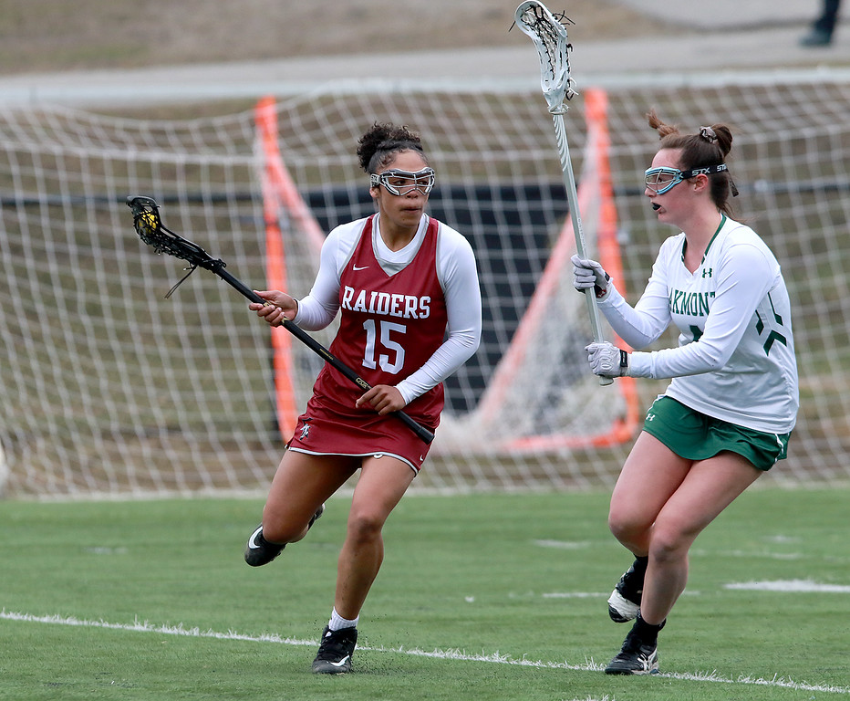 . Fitchburg High School girls Lacrosse played Oakmont Regional High School on Tuesday afternoon in Ashburnham, April 9, 2019. ORHS\'s Audrey Dolan plays some defense on FHS\'s Diandra Boddie. SENTINEL & ENTERPRISE/JOHN LOVE