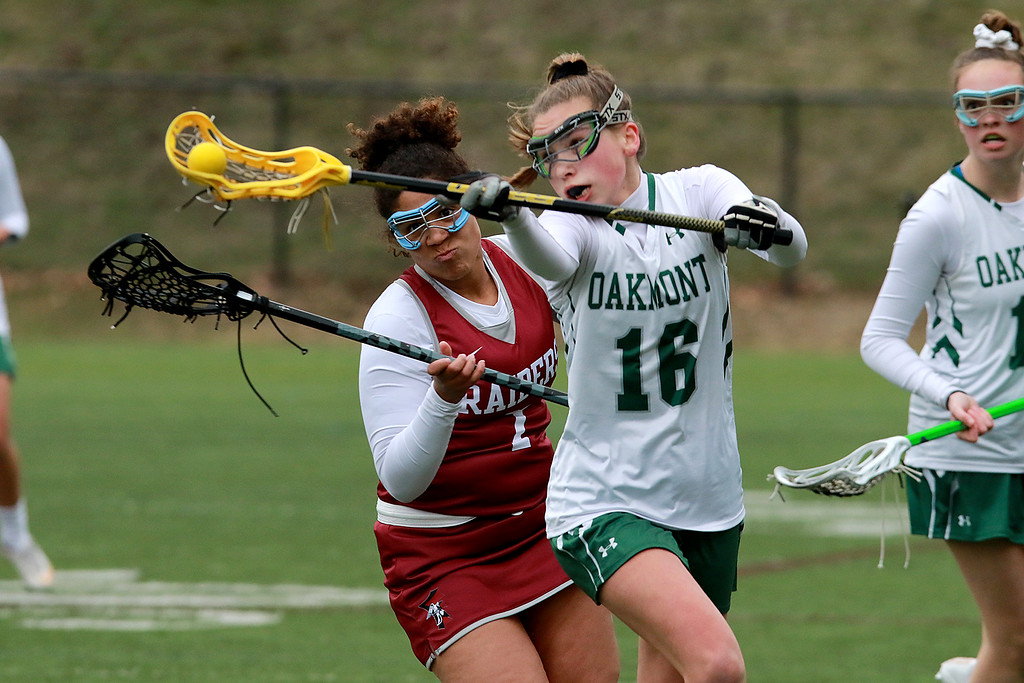 . Fitchburg High School girls Lacrosse played Oakmont Regional High School on Tuesday afternoon in Ashburnham, April 9, 2019. ORHS\'s Allyson Foley gets conmtrol of the ball followed by FHS\'s Jayda kalaco. SENTINEL & ENTERPRISE/JOHN LOVE