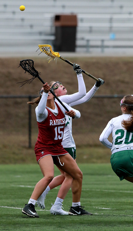 . Fitchburg High School girls Lacrosse played Oakmont Regional High School on Tuesday afternoon in Ashburnham, April 9, 2019. ORHS\'s Allyson Foley and FHS\'s Diandra Boddie fight for control of the ball on a face-off. SENTINEL & ENTERPRISE/JOHN LOVE